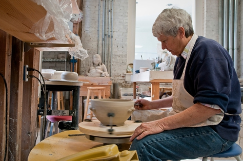 Jan Ahart sands down a ceramic bowl at the Bosque Arts Center in Clifton.