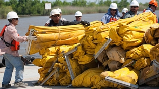 Contracted workers from U.S. Environmental Services organize boom for deployment at the Venice, La., staging area Thursday, April 29, 2010. Staging areas have been placed in areas so quick deployment of assets and personnel could be utilized to protect environmentally sensitive areas.