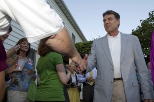 Gov. Rick Perry campaigns at a private reception in Cedar Rapids, Iowa, on Aug. 15, 2011.