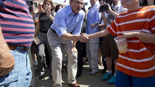 Texas Governor and presidential hopeful Rick Perry campaigns at the Iowa State Fair on Monday, two days after entering the race for the Republican nomination for President.