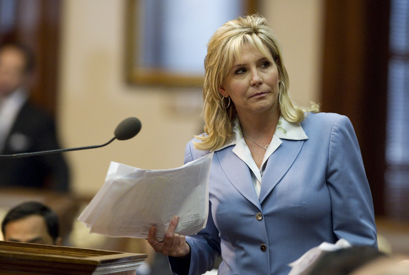 State Rep. Patricia Harless, R-Spring, turns away from the front microphone after answering a question during voter ID debate on March 23, 2011.