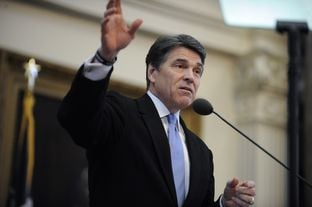 Governor Rick Perry offers words of advice to new and veteran House members during a speech on the opening of the 83rd Legislative Session on January 8, 2013