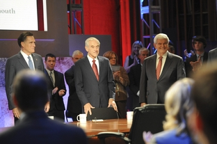 Mitt Romney, Ron Paul and Newt Gingrich at the Republican presidential debate at Dartmouth College on Oct. 11, 2011.