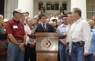 Texas Governor Rick Perry hosts a press conference with the Texas Association of Business leaders on April 6, 2006 at the Governor's Mansion.