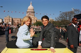 First Lady Anita Perry (l) and Rick Perry during the inaugural parade on January 21, 2003.
