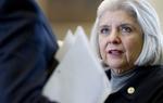 State Sen. Judith Zaffirini, D-Laredo, goes over SB5 higher education bill on the Senate floor on April 28, 2011.