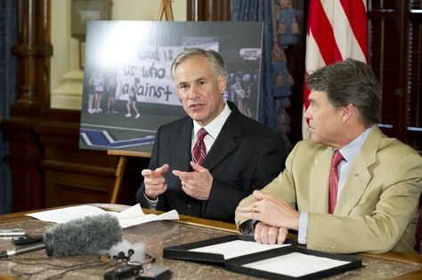 Attorney General Greg Abbott, left, and Gov. Rick Perry