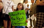 Young girl holds up sign during school budget rally at Texas Capitol June 6th, 2011