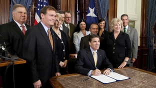 Gov. Rick Perry ceremonially signs Senate Bill 7, with Rep. John Zerwas R-Simonton and Sen. Jane Nelson R-Flower Mound on July 18th, 2011