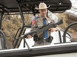 Texas DPS agent Cuevas removes a M2-40 machine gun from newly commissioned patrol vessel. The boat, part of the Tactical Marine Unit, funded by federal Homeland Security grants, will help with the state's efforts in combating Mexican drug cartels patrolling the Rio Grande River
