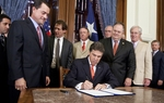 Gov. Rick Perry ceremonially signs Senate Bill 18, which implements landmark eminent domain joined by Ag. Comm. Todd Staples, Sen. Craig Estes R-Whichita Falls, and Rep. Charlie Geren, R-River Oaks on May 23rd, 2011
