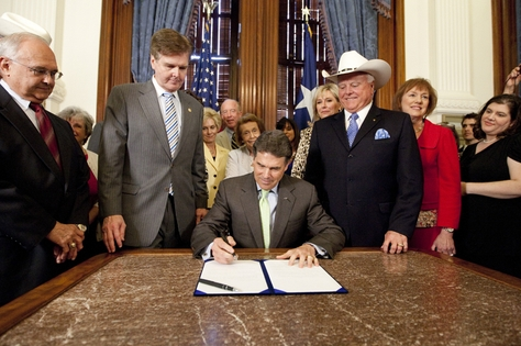 Gov. Perry ceremonially signs HB 15, which requires a woman to have a sonogram before an abortion. He is joined by Sen. Dan Patrick R-Houston and Rep. Sid Miller R-Stephenville on May 24th, 2011