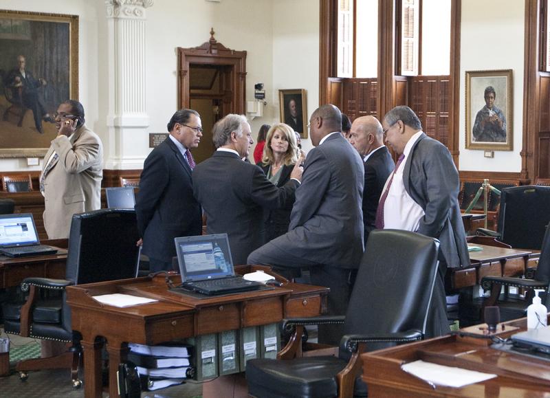 Group of Texas Senate Democrats huddle on Senate floor during break on May 30th, 2011
