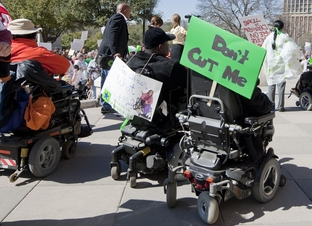 People with disabilities protest at the Texas Capitol against budget cuts to home and community-based services on March 1, 2011.
