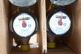 Installing a new electronic meter will enable utilities to measure water use remotely.