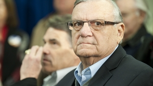 Arizona sheriff Joe Arpaio looks at the crowd before his introduction with candidate Rick Perry in Osceola, Iowa on December 27, 2011.