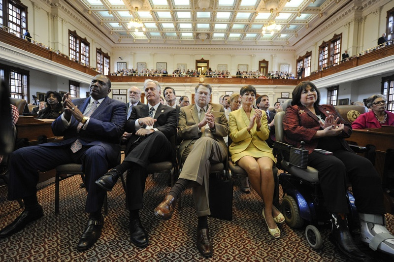 State Senators applaud Gov. Perry's State of the State speech on Jan. 29, 2013.