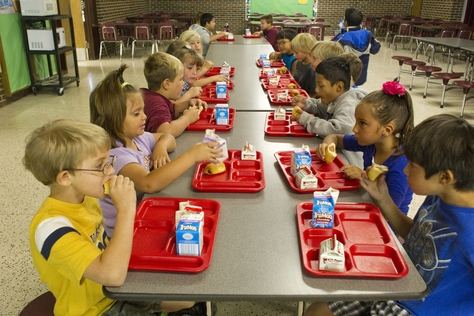 Elementary school students eat breakfast to start the day at Paint Creek school in Haskell County, Texas on September 22, 2011.