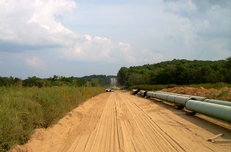 Pipe sections in Illinois await crews to weld and bury them during construction in 2009. This segment of the $12 billion Keystone pipeline project has already been built; a proposed pipeline through Texas still awaits government permits.