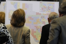 House members look at redistricting maps in the House chamber on April 27, 2011