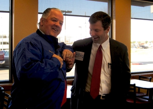 Rep. Tommy Merrit (left) and his Republican primary challenger David Simpson (right) unexpectedly run into each other as both court Longview's Chick-Fil-A breakfast club.