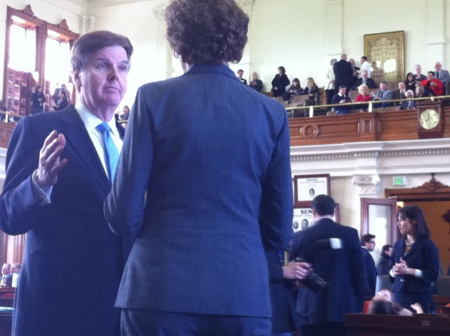 Dan Patrick talks with comp Susan combs in senate chambers.