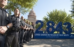 "Austin police officers stand in front of the Capitol to kick off the 10th anniversary of ""Click it or Ticket"" on May 3, 2011."