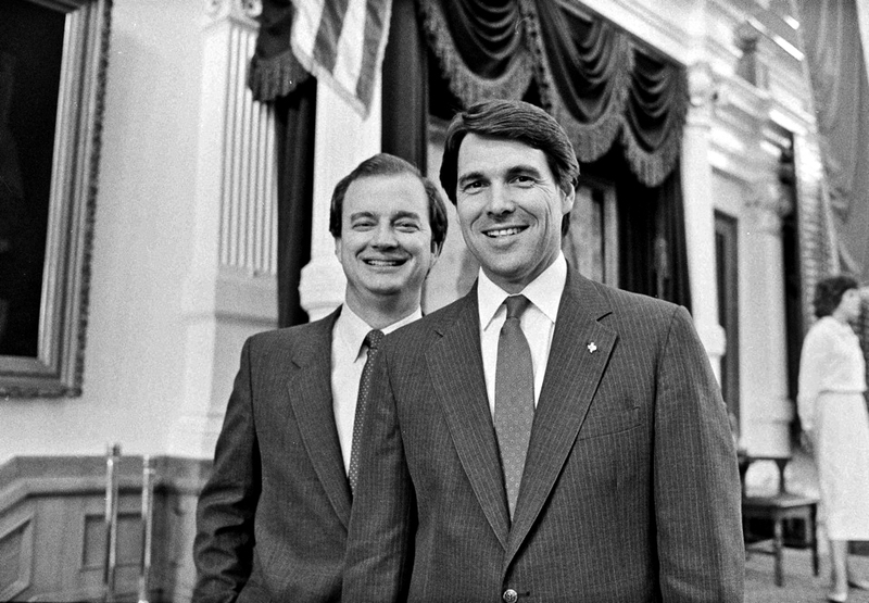 State Rep. Rick Perry with Railroad Commissioner John Sharp (D) on the floor of the House during the 70th Legislative session, May 20, 1987.