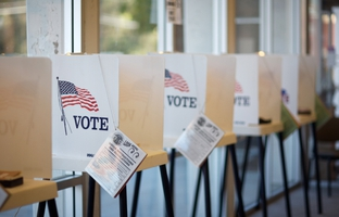 Much of the attention in this year's November elections has focused on Proposition 6, a water infrastructure initiative. But some are watching the mechanics of the election to find out how a newly implemented voter ID law affects voters.