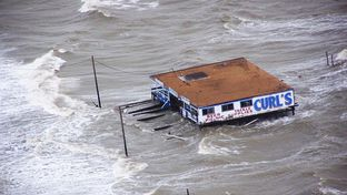 Joint Task Force-129 crew, Jolly 92, flies over the storm surge that overtook the Bolivar Peninsula bridge near Galveston, Texas, Sept. 12, 2008.