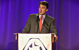 Gov. Rick Perry called on dedicating future growth in the state's motor vehicle sales taxes to be used to pay for road projects.