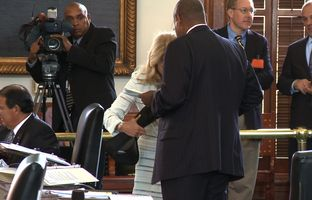 Raw video of Sen. Rodney Ellis, D-Houston, helping Sen. Wendy Davis, D-Fort Worth put on a back-brace during her filibuster.