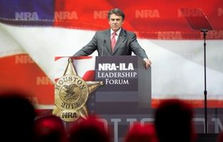 "Just like a baseball player's ""walk-up"" song, Gov. Rick Perry emerged from the dugout at the National Rifle Association's 2013 annual meeting after this video of him laying waste to a perfectly good farm egg and some other targets."
