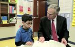 In a new online ad, Attorney General Greg Abbott, a Republican candidate for governor, highlights a series of policy roundtables he has hosted. They are part of his campaign's efforts to gather information for a more detailed package of education policy proposals he is expected to announce in January.