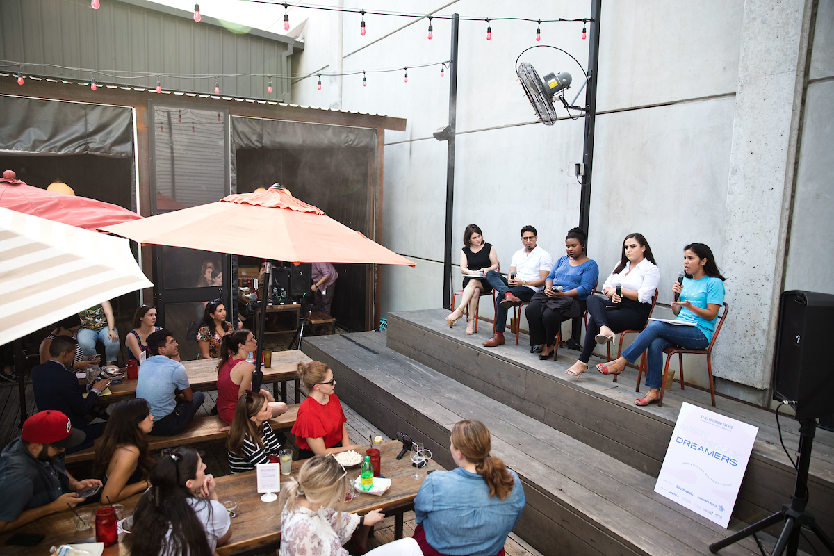 Panelists for the Summer Salons: Meet Texas Dreamers event speak to the crowd at Irene's in Austin, Texas.