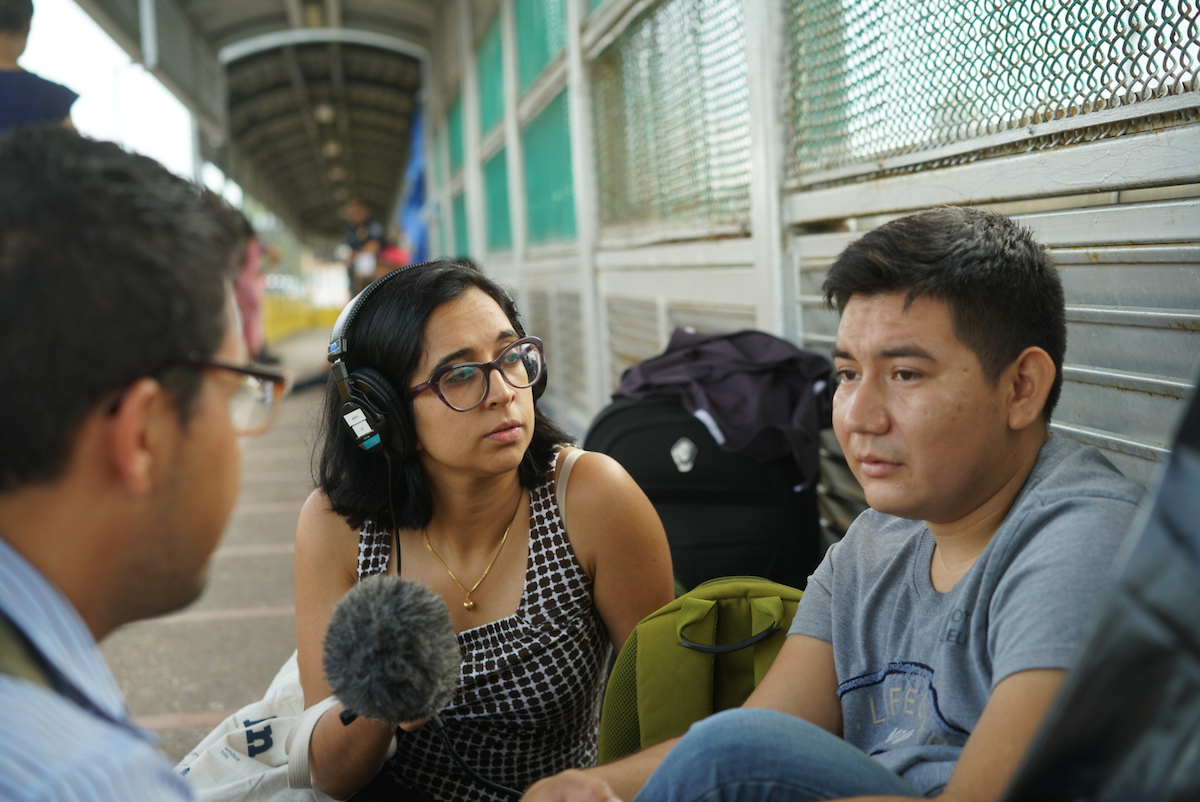 Investigative reporter Neena Satija interviews a Guatemalan migrant whose wife and four children were separated at the Texas-Mexico border.